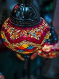 Amazing and elegant photo of ornate and colourful red Turkish light hanging from the ceiling. royalty free stock images