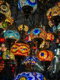 Amazing and elegant photo of ornate and colourful Turkish lights hanging from the ceiling. Amazing and elegant photo of ornate and colourful red, blue, yellow stock photo