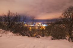 Amazing evening cityscape of PodilPodol district at winter stock image