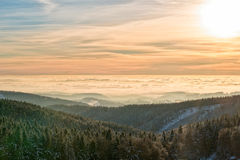 Amazing evening with sunset in Eagle mountains. Beautiful sunset within inversion Stock Photo
