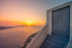 Amazing evening view of Fira, caldera, volcano of Santorini, Greece. Stock Photos