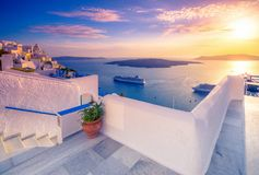 Amazing evening view of Fira, caldera, volcano of Santorini, Greece with cruise ships at sunset. royalty free stock photos