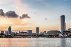 Amazing evening view of Marina Bay and downtown of Singapore. Scenic old colonial and modern buildings are visible at sunset. Singapore is a popular tourist stock image