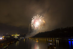 Amazing exploding yellow firework celebration of the new year 2015 in Prague with the historic city in the background Stock Images