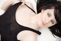Amazing eyes of brunette woman lying down Royalty Free Stock Photo
