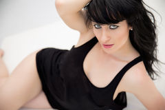 Amazing eyes of brunette woman lying down Royalty Free Stock Photography