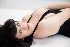 Amazing eyes of brunette woman lying down Royalty Free Stock Images