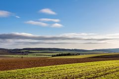 Amazing fall countryside with fields, forests and blue sky royalty free stock photography