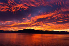 Amazing fiery burning evening sky Stock Images