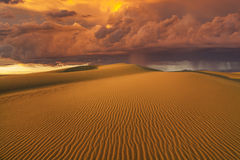 Amazing fiery rain clouds over the Gobi desert. Royalty Free Stock Photography