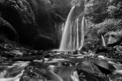 Amazing fine art black and white Tiu Kelep Waterfall near Rinjani, Senaru Lombok indonesia. Southeast Asia. Motion blur and soft focus due to Long Exposure stock images