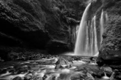 Amazing fine art black and white Tiu Kelep Waterfall near Rinjani, Senaru Lombok indonesia. stock image