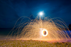 Amazing Fire dancing Steel Wool Photography Stock Photo