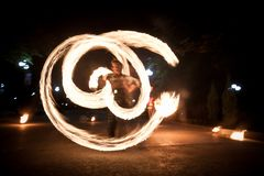 Amazing fire show dance. Fire dancer playing with flame royalty free stock photos