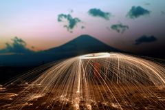 Amazing Fire steel wool . Amazing  Fire steel wool with mountain fuji royalty free stock photography