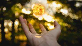 Amazing fireball in a hand. Autoral work for my personal project `Almost 365` shooted in Chile stock photography