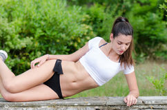 Amazing fit women with short shirt show off her flat tummy Royalty Free Stock Images