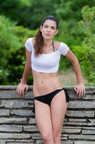 Amazing fit women with short shirt show off her flat tummy Stock Images