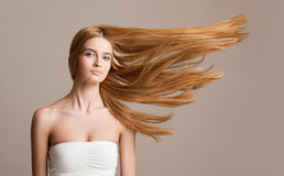 Amazing flowing blond hair. Stock Photos