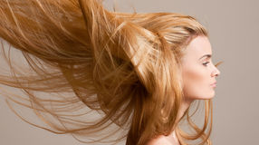 Amazing flowing blond hair. Royalty Free Stock Photos