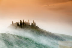 Amazing foggy sunrise in countryside of Tuscany, Italy Royalty Free Stock Image