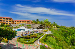 Amazing fragment of view of Sol Rio de Luna y Mares hotel and grounds with people relaxing in background Stock Photo