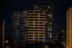 Amazing fragment of view of stylish modern residential buildings background at late dark evening time Stock Image