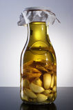 Amazing fragrant tangy homemade infused garlic ginger olive oil. Bottle of fragrant tangy home made garlic ginger olive oil Stock Photos