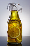 Amazing fragrant tangy homemade infused lemon olive oil. Bottle of home made lemon infused lemon olive oil Royalty Free Stock Photos