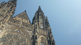 Amazing frontal view and panorama of ancient gothic church St Vitus cathedral to blue sky. In Prague in sunny day stock video