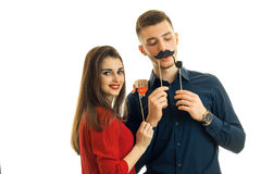 Amazing fun couple keep near persons paper Dummies for photo and laughing Stock Images