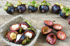 Amazing, funny, mangosteen, worried, anxiou face. Amazing background with funny idea, impersonation, mangosteen with worried, anxious, humorous face, contrast Royalty Free Stock Photography