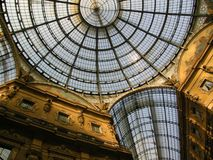 Amazing Galleria Milan Italy. The shopping district  with Galleria Vittorio Emmanuele II the first ever shopping centre and its amazing glass roof architecture Royalty Free Stock Photos