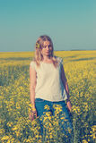 Amazing girl, blonde with a bright wildflower in her hair Stock Images