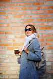 Amazing girl in sunglasses with coffee holding bag Stock Photography