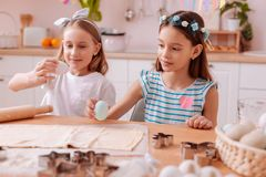 Amazing girls spending weekends together at home. Best friends. Pretty little females expressing positivity while going to cook dessert stock photography