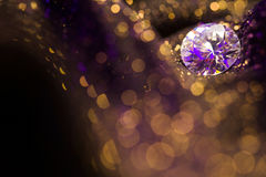 Amazing glitter and glow soft multi colored bokeh shining with big natural jewelry precious stone. Dark abstract dreamy wunderful Royalty Free Stock Image