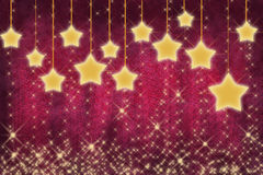 Amazing glowing yellow stars on wine red stock images