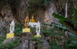Amazing gold buddha statue in beautiful nature perched on a cliff side Royalty Free Stock Photography