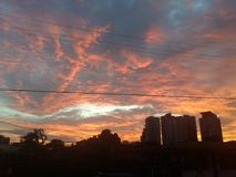 Amazing golden color of the sky. Amazing golden color of sky for sunset, clouds, scene up above with a building royalty free stock image