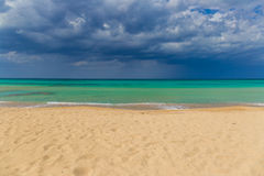 Amazing golden sand beach near Monopolli Capitolo, amazing atmosphere during stormy day, Apulia region, Southern Italy Royalty Free Stock Image