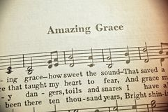 Amazing Grace. This Christian hymn was written by English poet and Anglican Clergyman John Newton in 1772. Amazing Grace remains one of the most popular hymns royalty free stock image