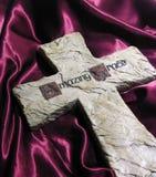 Amazing Grace Cross. A photo of a cross on velvet Stock Photo