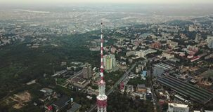Cityscape with TV tower. Amazing green cityscape with the TV Tower in Kyiv in Ukraine. Aerial video recording stock footage