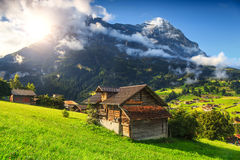 Amazing Grindelwald resort and Eiger mountains, Bernese Oberland, Switzerland, Europe. Fabulous alpine wooden houses, green fields and famous touristic royalty free stock photo