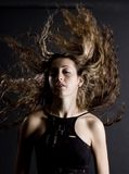 Amazing Hair. A woman flicks her amazing hair above her head Royalty Free Stock Photos