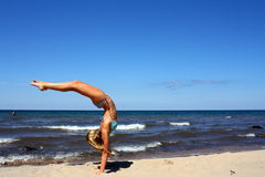 Amazing handstand on the beach Royalty Free Stock Image