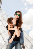 Amazing happy couple having a lot of fun outside in the city Royalty Free Stock Photo