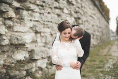 Amazing happy gentle stylish beautiful romantic caucasian couple on the background ancient baroque castle.  Royalty Free Stock Photo