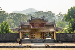 Amazing Hien Duc Gate at the Minh Mang Tomb, Hue. Amazing view of red gilded Hien Duc Gate at the Minh Mang Tomb in Hue, Vietnam. Hue is a popular tourist royalty free stock images